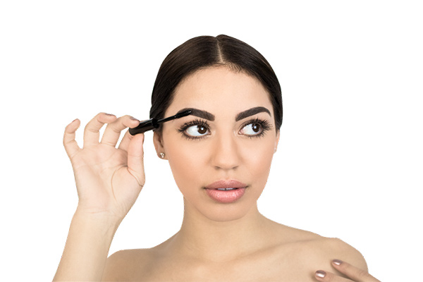 woman applying a tinted brow gel