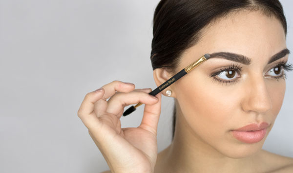 woman using the dual brow brush