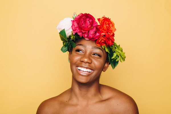 rectangle faced woman wearing a floral crown