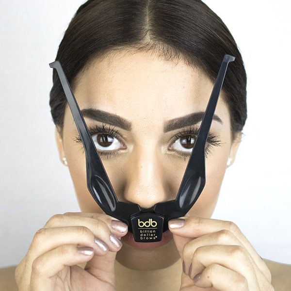 woman completing step 2 brow buddy kit