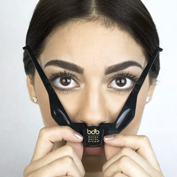 woman completing step 3 brow buddy kit