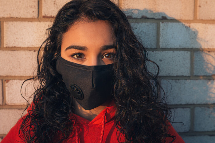 woman with arched brows wearing a black mask