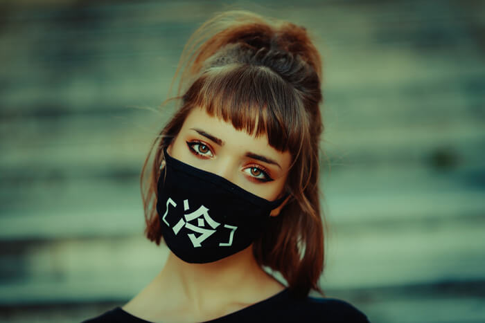 woman with straight brows wearing a mask